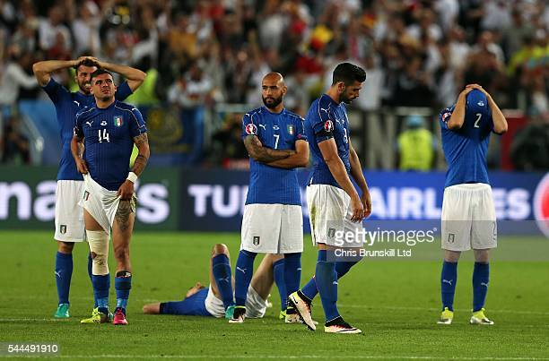 Italy look dejected following the penalty shoot out during the UEFA Euro 2016 Quarter Final match between Germany and Italy at Nouveau Stade de...