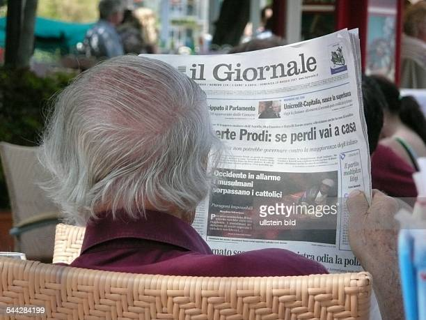 Italy man is reading the newspaper il Giornale in a cafe