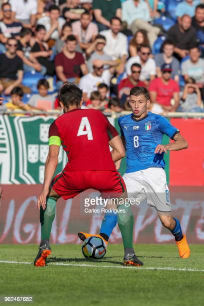 Italy midfielder Nicolo Barella tries to pass trough Portugal defender Jorge Fernandes during the International Friendly match between Portugal U21...