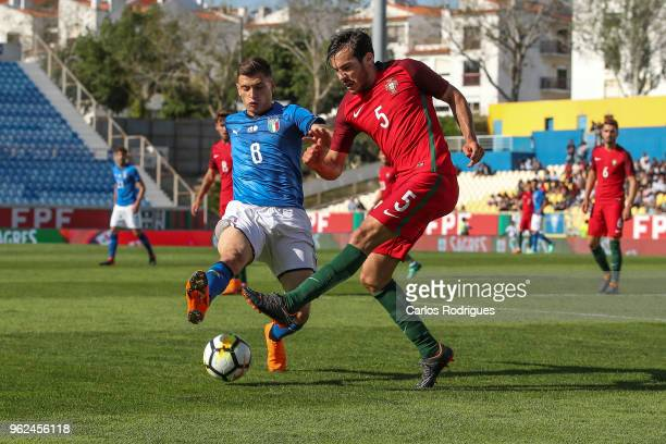 Italy midfielder Nicolo Barella vies with Portugal defender Yuri Ribeiro for the ball possession during the International Friendly match between...
