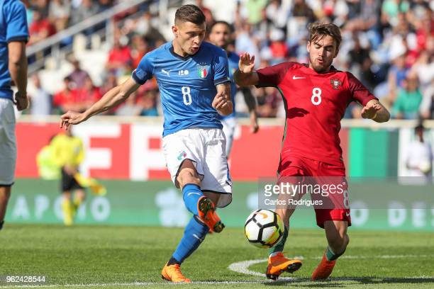Italy midfielder Nicolo Barella vies with Portugal midfielder Andre Horta for the ball possession during the International Friendly match between...