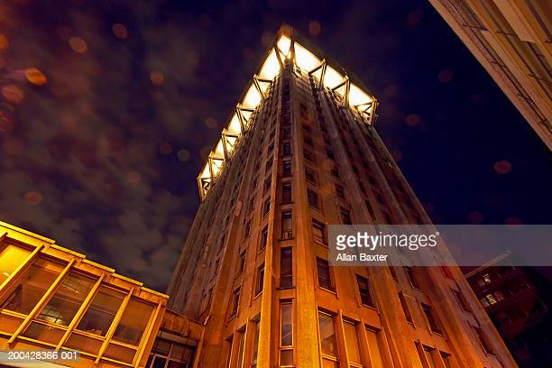 Italy, Milan, Torre Velasca tower illuminated, dusk, low angle view