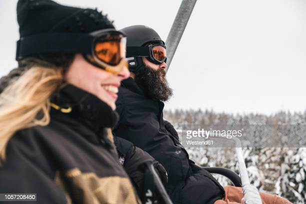 Italy, Modena, Cimone, couple in a ski lift