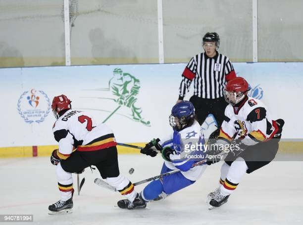 Italy Mostovoy of Israel in action against Jefie Versin during the 2018 IIHF Ice Hockey U18 Men's World Championship match between Belgium and Israel...