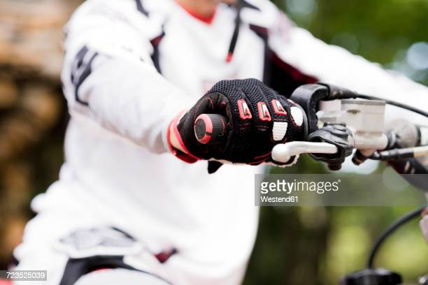 italy, motocross biker rinding in tuscan forest - handlebar stock photos and pictures