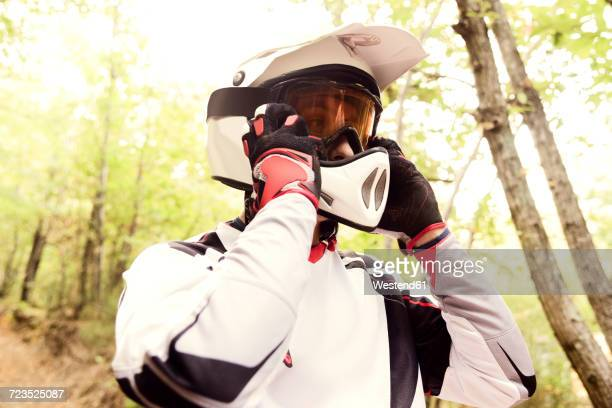 Italy, Motocross biker rinding in Tuscan forest