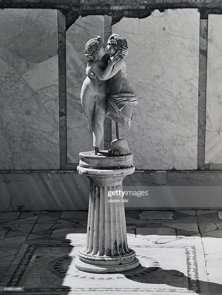Italy, Rome, Ostia Antica, antique Roman sculpture of god Amour and Psyche. : News Photo