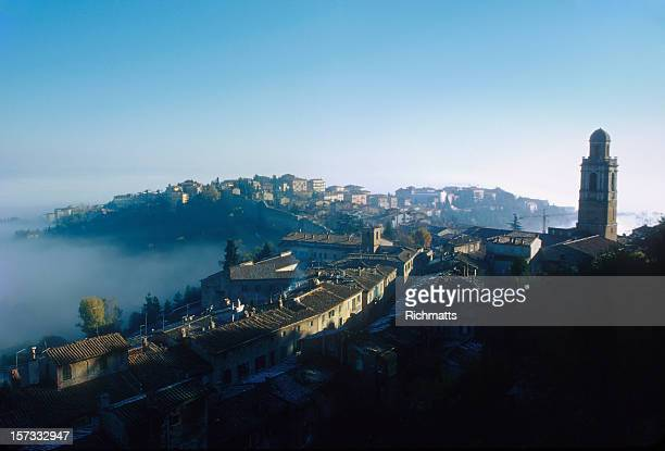 italy. perugia rising from the morning mist - perugia stock pictures, royalty-free photos & images