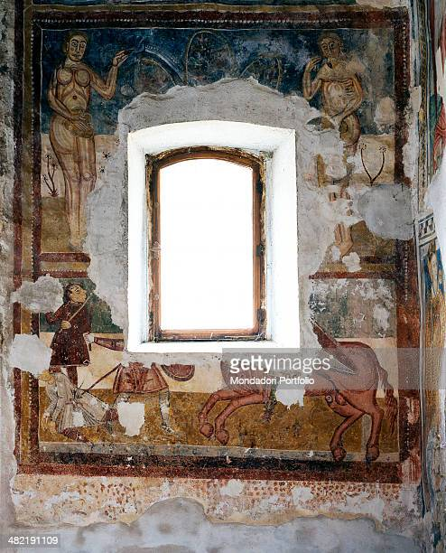 Italy Piedmont Macra Saint Salvatore Chapel Whole artwork view Partially lost frescoes disposed on two lines around a window