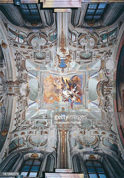 Italy Piedmont Saluzzo Chiesa di San Bernardino Ceiling decorated with golden squaring up where dominates the figure of Saint Bernardino The...