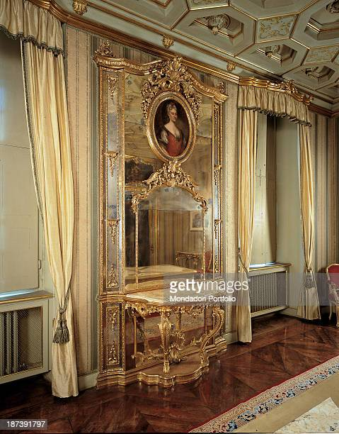 Italy Piedmont Turin Palazzo Saluzzo di Paesana Total Wall table with mirror and oval portrait painting Golden decoration with foliage and scrolls