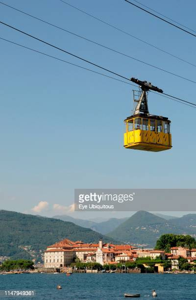 Italy. Piemonte. Lake Maggiore. Stresa. Cable car above lake with Isola Bella in background.