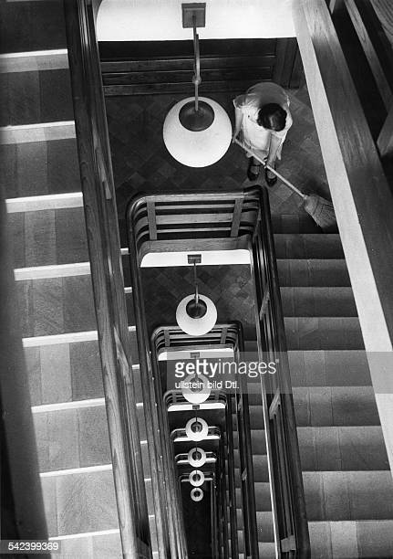 Italy Piemonte Sweeping the floor of the staircase in the hotel 'Principi di Piemonte' in Sestriere 1934 Photographer Alfred Eisenstaedt Vintage...