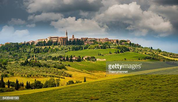 Italy, Pienza, Landscape with old town on top of hill and sky with clouds