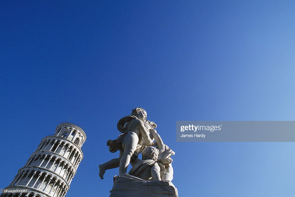 Italy, Pisa, leaning tower and statue : Stock Photo