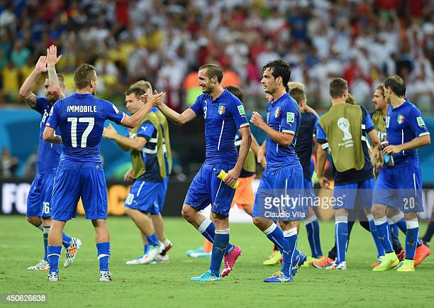 Italy players celebrate after defeating England 2-1 in the 2014 FIFA World Cup Brazil Group D match between England and Italy at Arena Amazonia on...