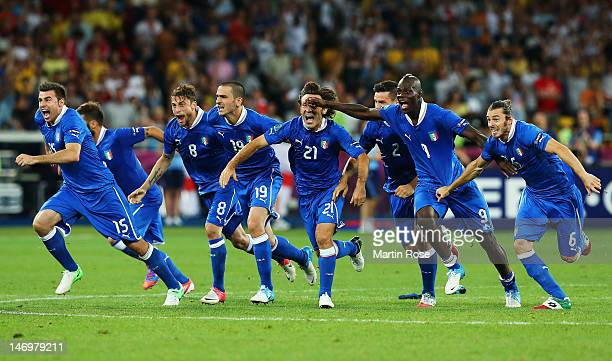 Italy players celebrate after the penalty shoot out during the UEFA EURO 2012 quarter final match between England and Italy at The Olympic Stadium on...