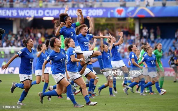 Italy players celebrate after victory in the 2019 FIFA Women's World Cup France Round Of 16 match between Italy and China at Stade de la Mosson on...
