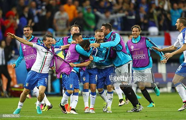 Italy players celebrate their team's second goal during the UEFA EURO 2016 Group E match between Belgium and Italy at Stade des Lumieres on June 13...