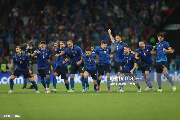 Italy players celebrate victory as Gianluigi Donnarumma of Italy saves the England fifth penalty taken by Bukayo Saka of England following the UEFA...