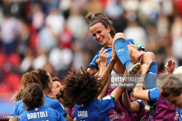 Italy players celebrate victory as they lift Barbara Bonansea of Italy in the air after the 2019 FIFA Women's World Cup France group C match between...