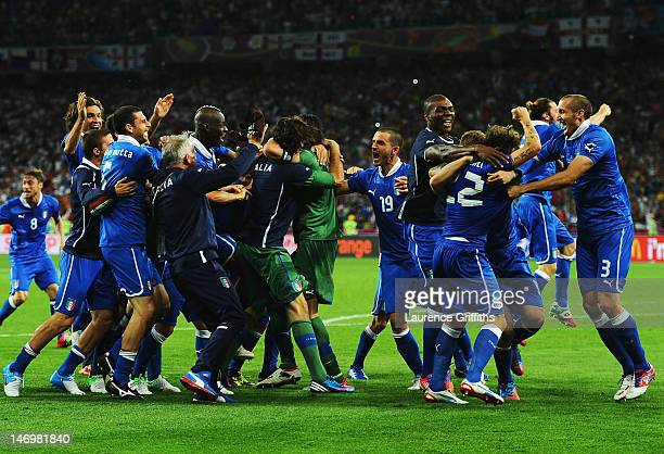 Italy players celebrate victory during the UEFA EURO 2012 quarter final match between England and Italy at The Olympic Stadium on June 24, 2012 in...