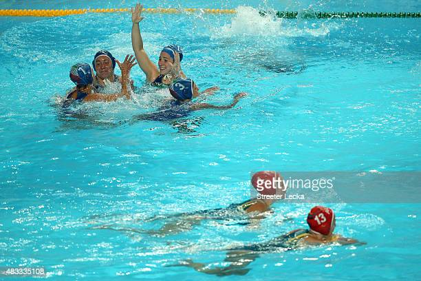 Italy players celebrate victory in the Women's bronze medal match between Australia and Italy on day fourteen of the 16th FINA World Championships at...