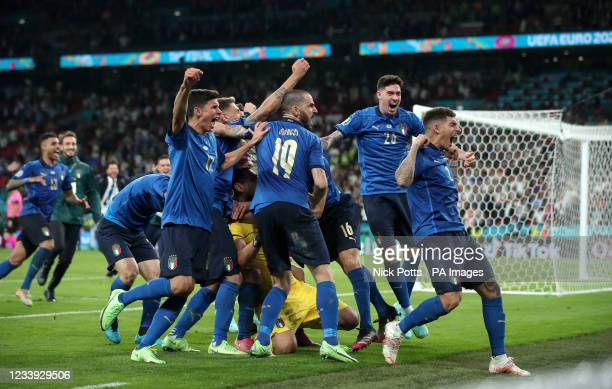 Italy players celebrate winning the penalty shoot-out after the UEFA Euro 2020 Final at Wembley Stadium, London. Picture date: Sunday July 11, 2021.