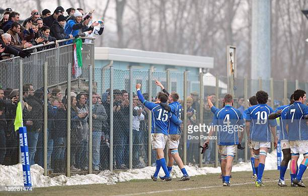 Italy players celebrates the victory with fans after the U18 rugby test match between Italy U18 and Ireland U18 on February 18 2012 in Badia Polesine...