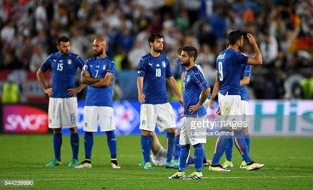 Italy players show their dejeciton after their defeat through the penalty shootout during the UEFA EURO 2016 quarter final match between Germany and...