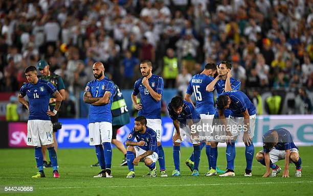 Italy players show their dejection after Matteo Darmian missed the penalty at the penalty shootout during the UEFA EURO 2016 quarter final match...