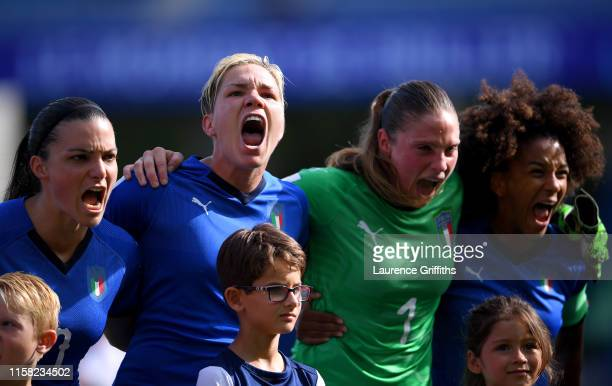 Italy players sing their national anthem prior to the 2019 FIFA Women's World Cup France Round Of 16 match between Italy and China at Stade de la...