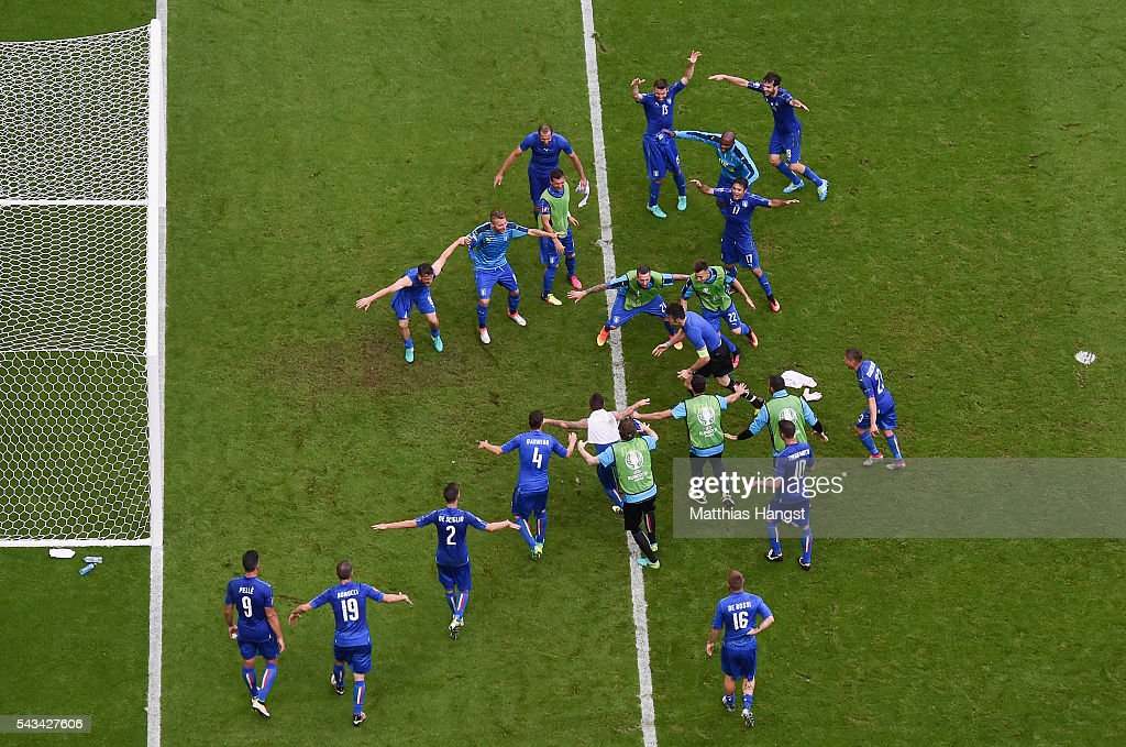 Italy players urge Gianluigi Buffon to jumps to cling on the crossbar to celebrates his team's 2-0 win in the UEFA EURO 2016 round of 16 match between Italy and Spain at Stade de France on June 27, 2016 in Paris, France.