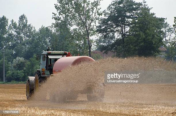 Italy Po Delta Saluzzo Vicinity Cuneo Pig Slurry Being Spread On Fields To Feed The Next Crop Of Maize Which Will Feed The Next Generation Of Pigs...