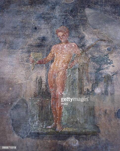 Italy, Pompeii. House of the Vettii. Young man playing the flute. 1st century AD.