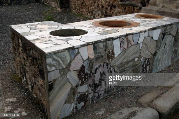 Italy Pompeii Marble covered counter Thermopolium Campania