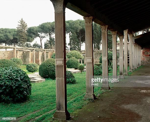 Italy. Pompeii.1st century AD. House of Julia. Garden surrounded by original marble-embellished quadrangular columns.