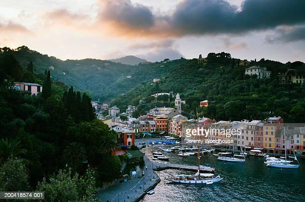 italy, portofino, liguria, portofino at sunset, elevated view - portofino stock pictures, royalty-free photos & images