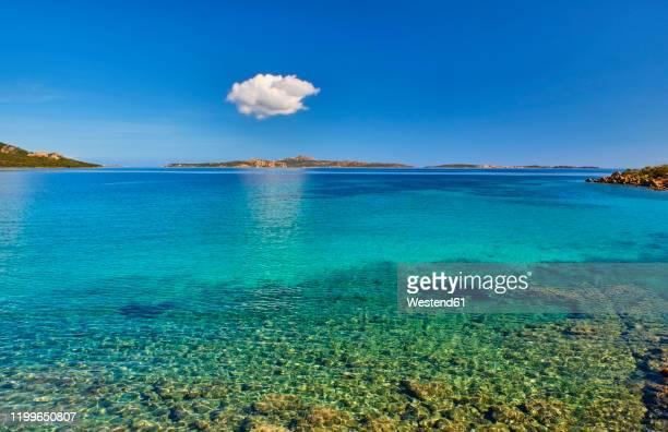 italy, province of sassari, la maddalena, single cloud floating over coastal waters of†strait of bonifacio - mer tyrrhénienne photos et images de collection