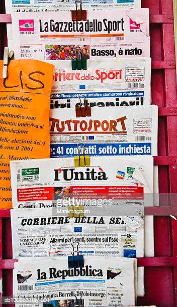 italy, puglia, alberobello, newspapers in rack outdoors - western script stock pictures, royalty-free photos & images