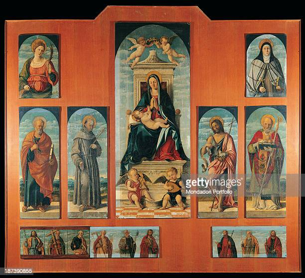 Italy Puglia Castellaneta Chiesa Madre All Polyptych depicting the Virgin Mary in the central panel with hands joined the infant Jesus lying on her...