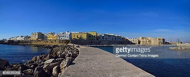 Italy, Puglia, Ostuni, City skyline from pier