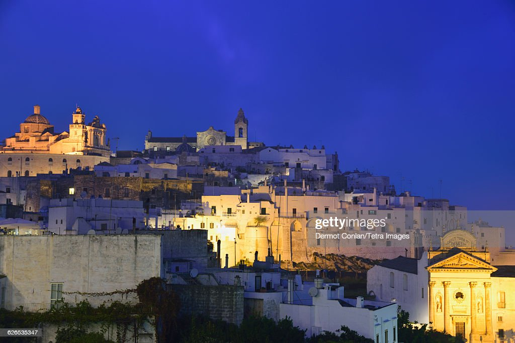 Italy, Puglia, Ostuni, Old town against sky at dusk : Stock Photo