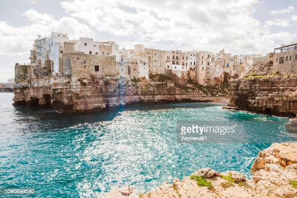 italy, puglia, polognano a mare, view to historic old town - italien stock-fotos und bilder