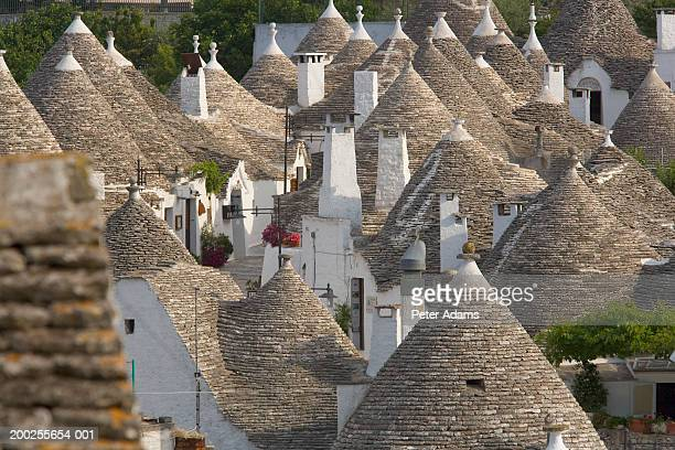 italy, puglia, the trulli area, alberobello, house roof tops - alberobello stock photos and pictures