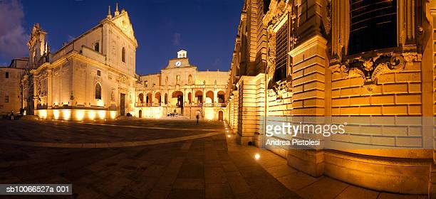 italy, puglie, lecce, piazza duomo at dusk - lecce stock photos and pictures