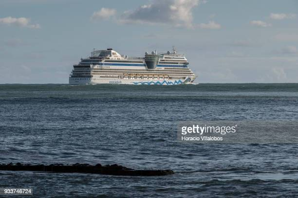 Italy registered cruise ship AIDAblu owned by Costa Crociere SpA and operated by AIDA Cruises sails off harbor on March 18 2018 in Lisbon Portugal...