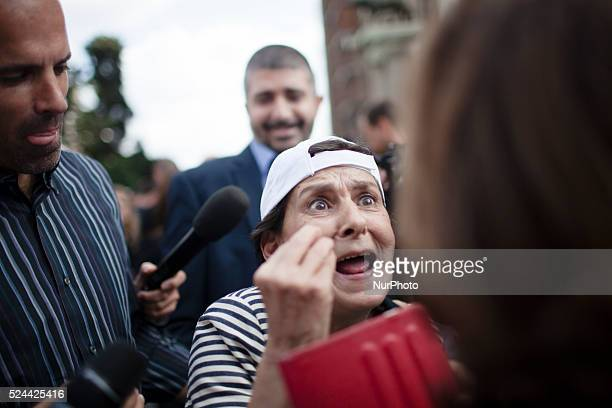 A woman argues with an opponent of Rome's Mayor Ignazio Marino on October 8 2015 outside Rome's City Hall at Piazza del Campidoglio Pro and anti...