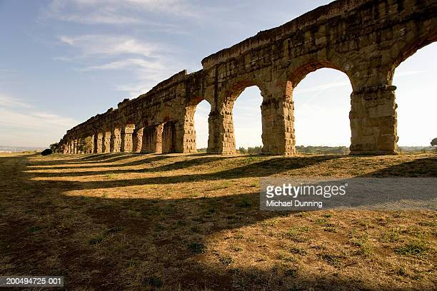 italy, rome, appian way, arches and shadows, outdoors - ancient stock-fotos und bilder