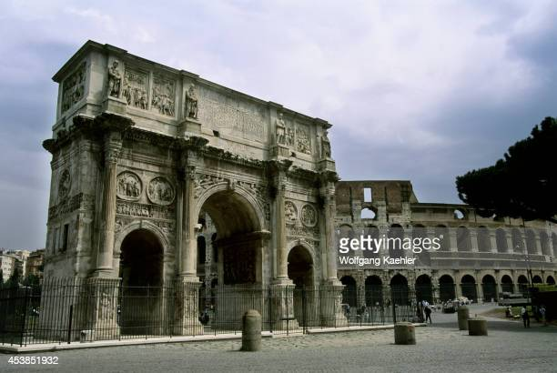 Italy Rome Arch Of Constantine Colosseum In Background
